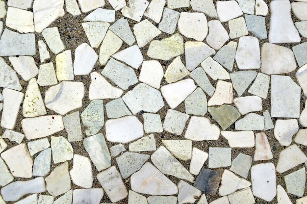 Fondo hecho de piezas de piedras blancas y grises