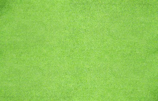 Fondo de hoja verde de césped artificial