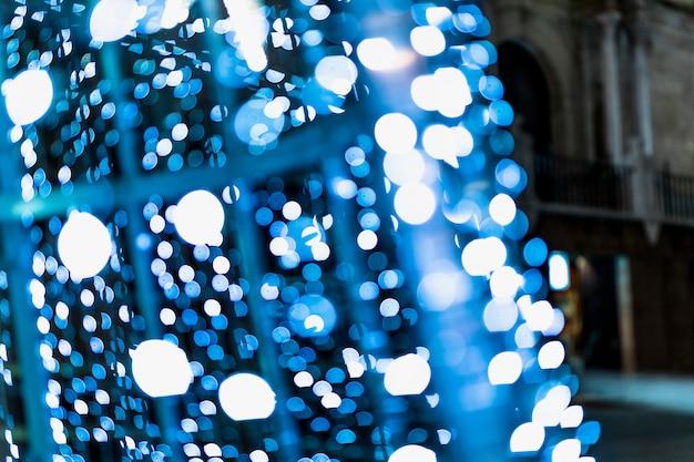 Fondo iluminado abstracto azul del bokeh