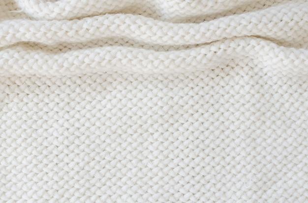 Fondo de lana de punto beige. textura de tejido de punto.