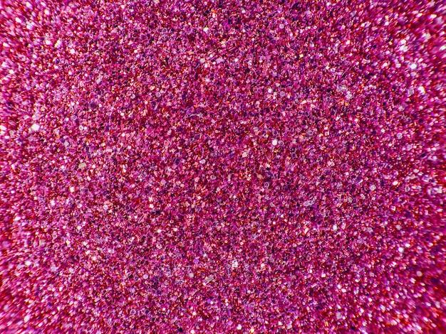 Fondo de lentejuelas. purpurina de color rosa de fondo.