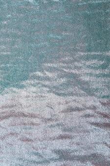 Fondo de lentejuelas turquesa transparente