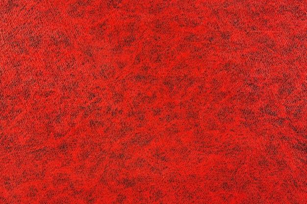 Fondo de libro rojo texturizado con patrones de granulado profundo