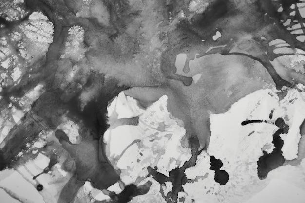 Fondo líquido abstracto de color blanco y negro. salpicaduras de pintura, arte fluido, concepto de papel tapiz científico