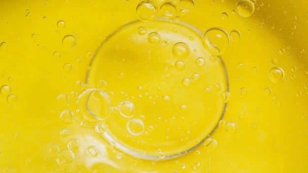 Fondo líquido amarillo vista superior