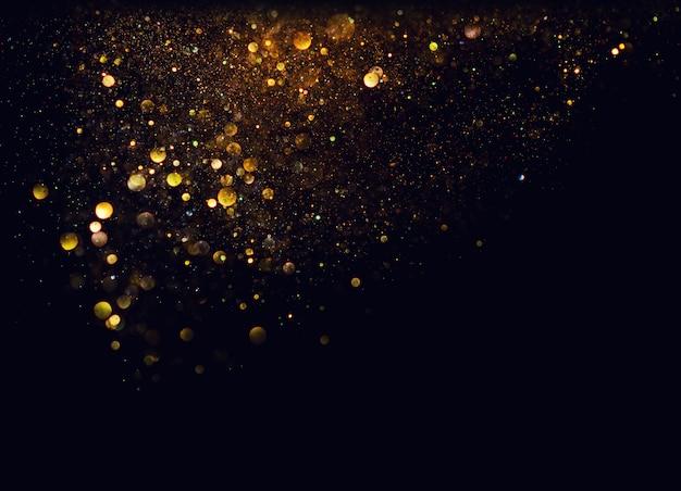 Fondo de luces vintage brillo. oro y negro. de enfocado