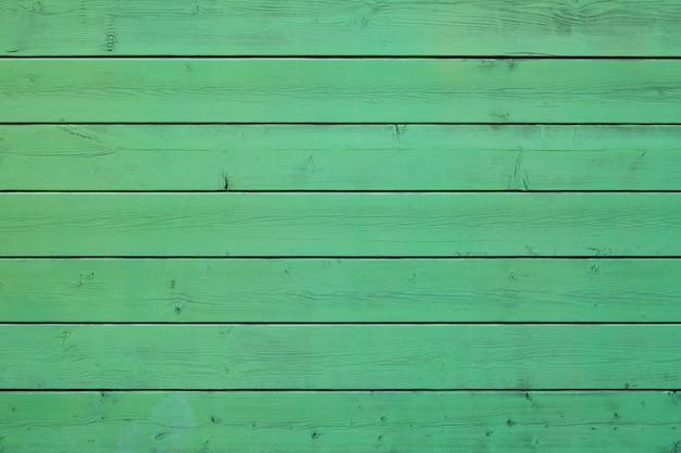 Fondo de madera en colores pastel de color verde.