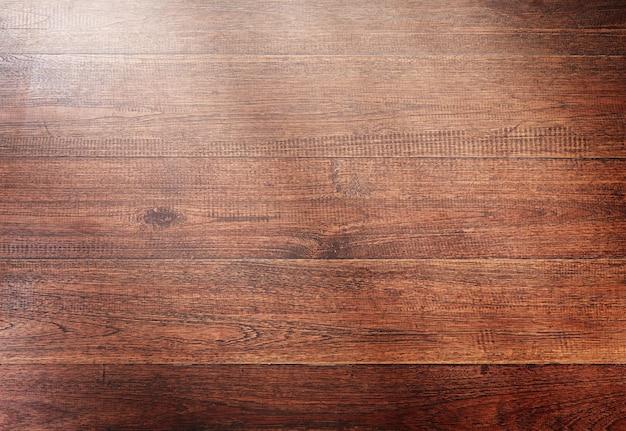 Fondo de madera con rayos de sol.