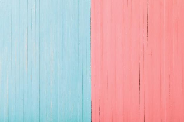 Fondo de madera rosa y azul. concepto de hombre y mujer