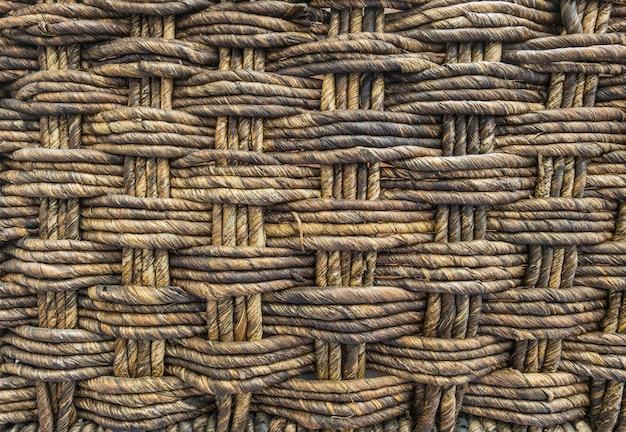 Fondo de madera de la textura de la cesta tejida del primer