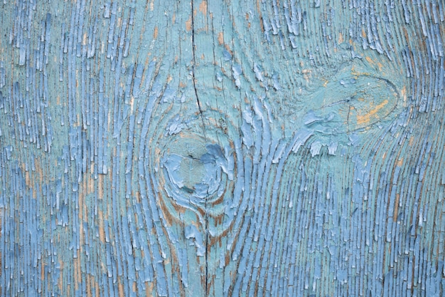 Fondo de madera vintage con pintura descascarada.