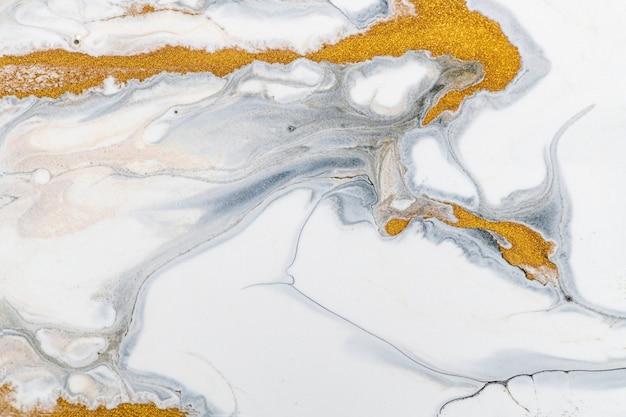 Fondo de mármol líquido blanco y dorado arte experimental de textura fluida de lujo de bricolaje