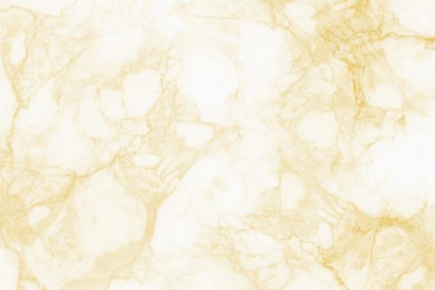 Fondo de mármol de la textura del oro para el diseño.