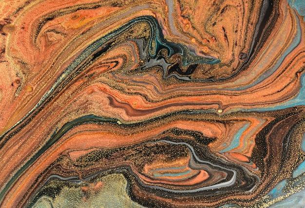 Fondo de marmoleado marrón y oro. textura líquida de mármol dorado.