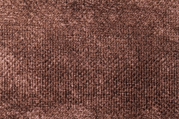 Fondo marrón oscuro de material textil suave. tejido con textura natural.