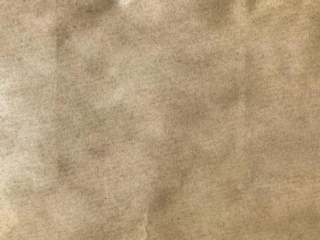 Fondo marrón oscuro de la pared de la textura de la superficie de la bolsa de papel.