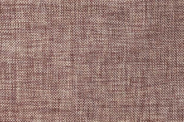 Fondo marrón oscuro de tejido densa de ensacado