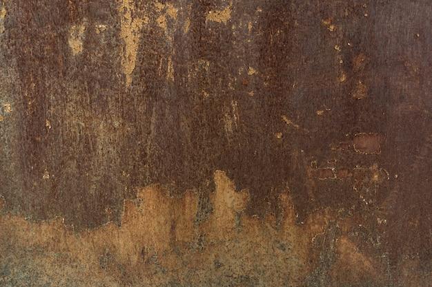 Fondo de metal grunge pintado de óxido o textura con arañazos y grietas