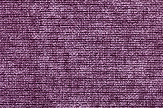 Fondo morado de material textil suave, tela con textura natural
