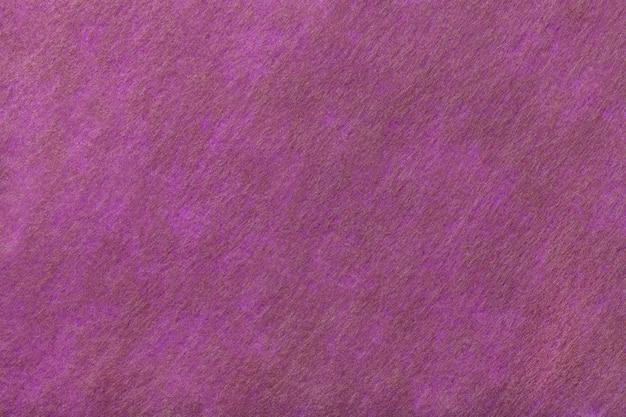 Fondo morado oscuro y marrón de tela de fieltro. textura de textil de lana
