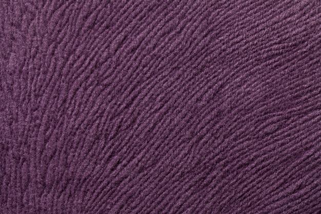 Fondo morado oscuro de materia textil suave