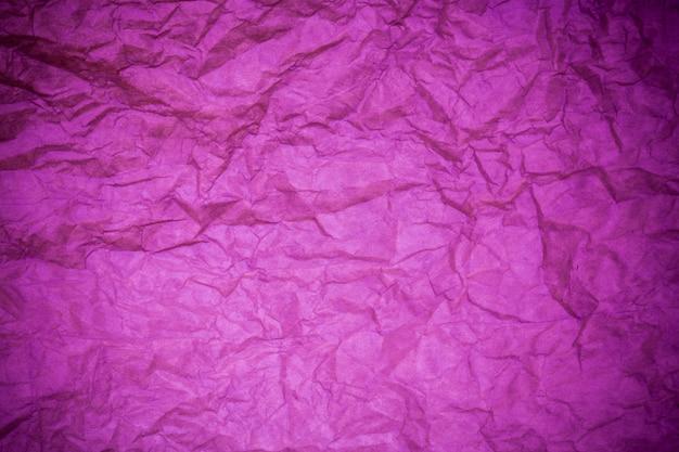 Fondo morado de papel con textura.