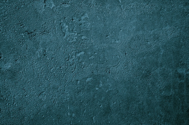 Fondo de muro de hormigón urbano con surcos y burbujas. pared de cemento gris.