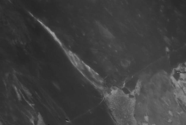 Fondo natural de mármol negro en blanco y negro.