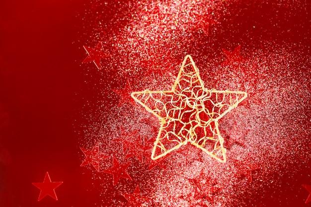 Fondo de navidad con estrellitas rojas