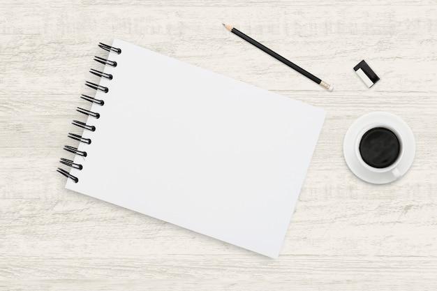 Fondo de negocios de la vista superior del cuaderno y taza de café en textura de madera.