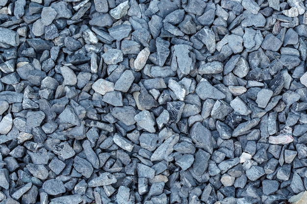 Fondo negro pequeño camino de piedra, piedras de grava oscura textura de piedra textura perfecta, granito, mármol