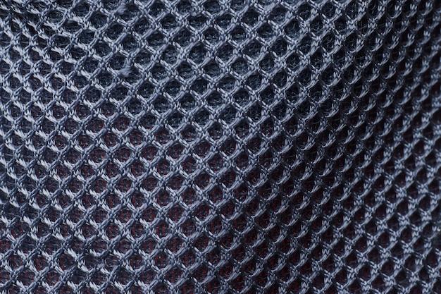 Fondo negro textura partes de malla de ropa deportiva.
