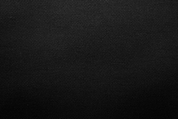 Fondo negro de la textura de la tela. detalle de material textil lienzo.