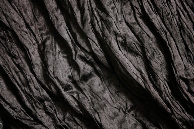 Fondo negro vacío con textura de arrugas