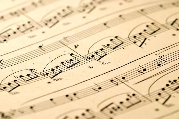 Fondo de notas musicales. enfoque selectivo, poca profundidad de campo.
