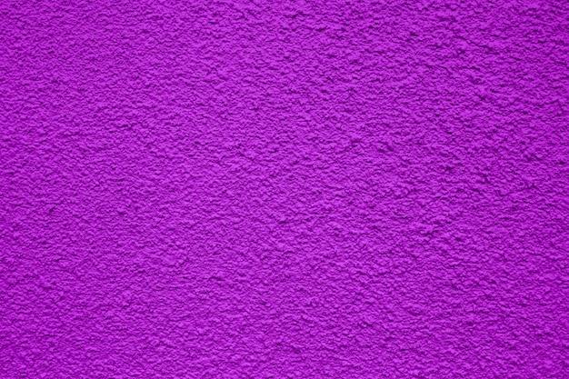 Un fondo o textura áspera de color púrpura para uso en construcción o pancartas