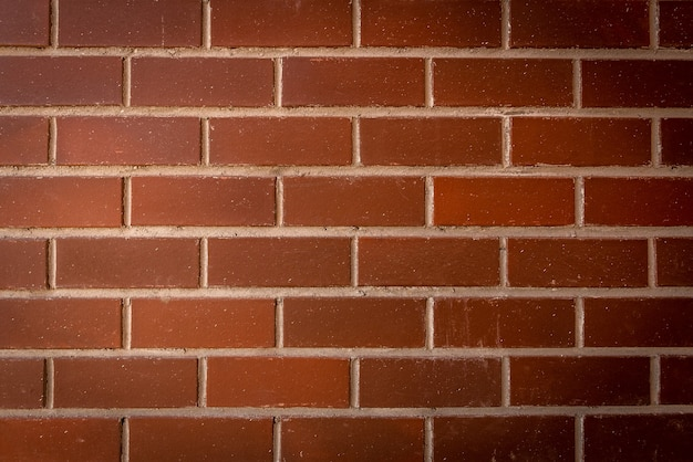 Fondo o textura de la pared de ladrillo rojo.