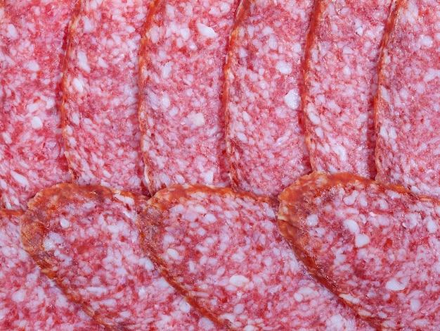 Fondo o textura de salchicha de salami ahumado. fotografía de cerca