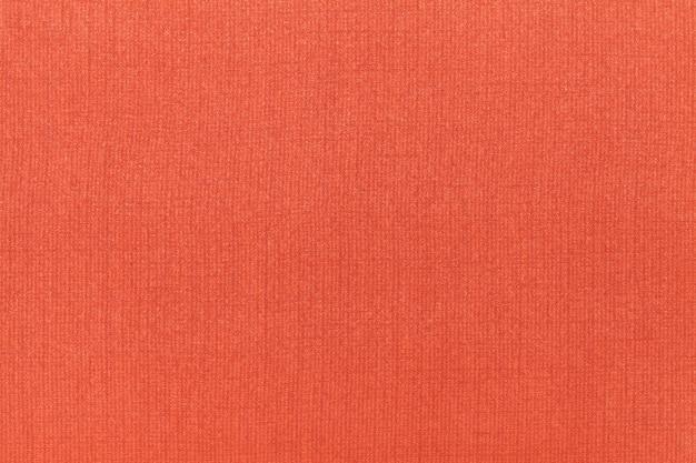 Fondo ocre naranja brillante de un material textil. tejido con textura natural.