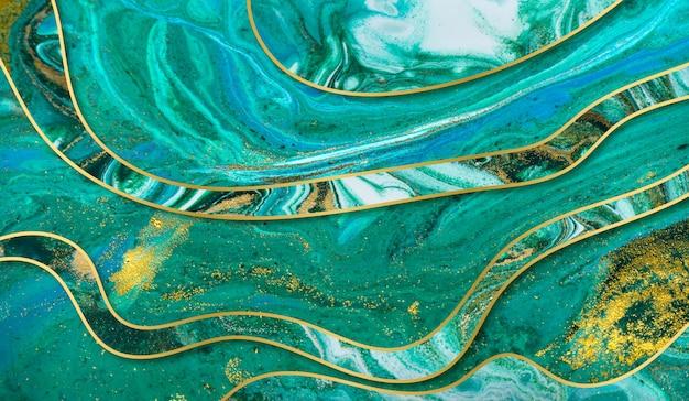 Fondo de ondulación de ágata verde y oro. mármol con capas onduladas.