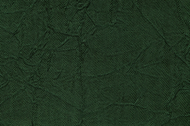 Fondo ondulado verde oscuro de un material textil