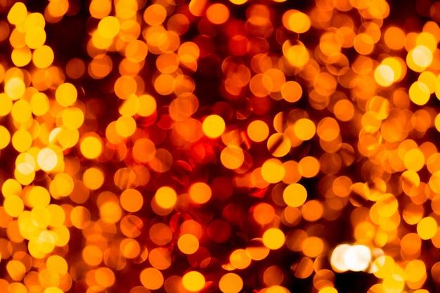 Fondo de oro abstracto festivo con bokeh desenfocada y borrosa muchos luz amarilla redonda