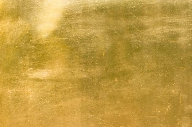 Fondo de oro o textura y degradados de sombra.