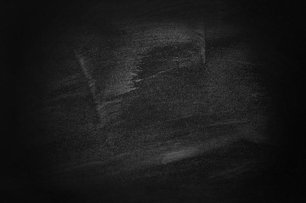 Fondo oscuro y negro de la pizarra