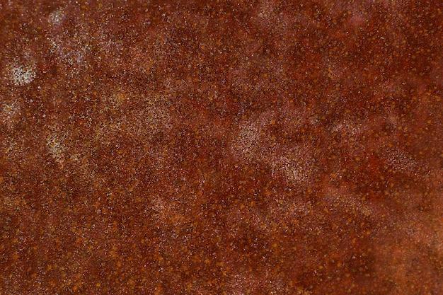 Fondo oxidado en colores marrón rojizo. grunge y superficie irregular.