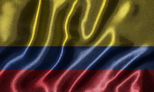 Fondo de pantalla de la bandera de colombia y ondeando la bandera por la tela.
