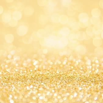Fondo de pantalla cuadrada de partículas doradas bokeh