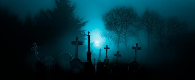 Fondo de pantalla de halloween con cementerio en la noche