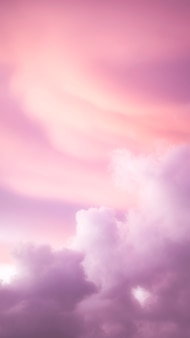 Fondo de pantalla de teléfono móvil cielo nublado rosa