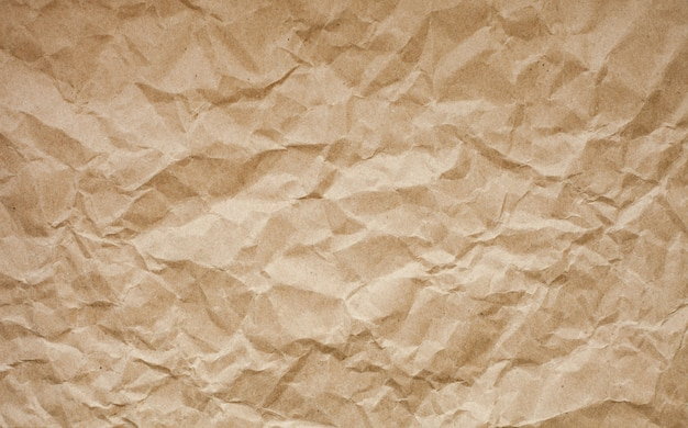 Fondo de papel arrugado marrón.